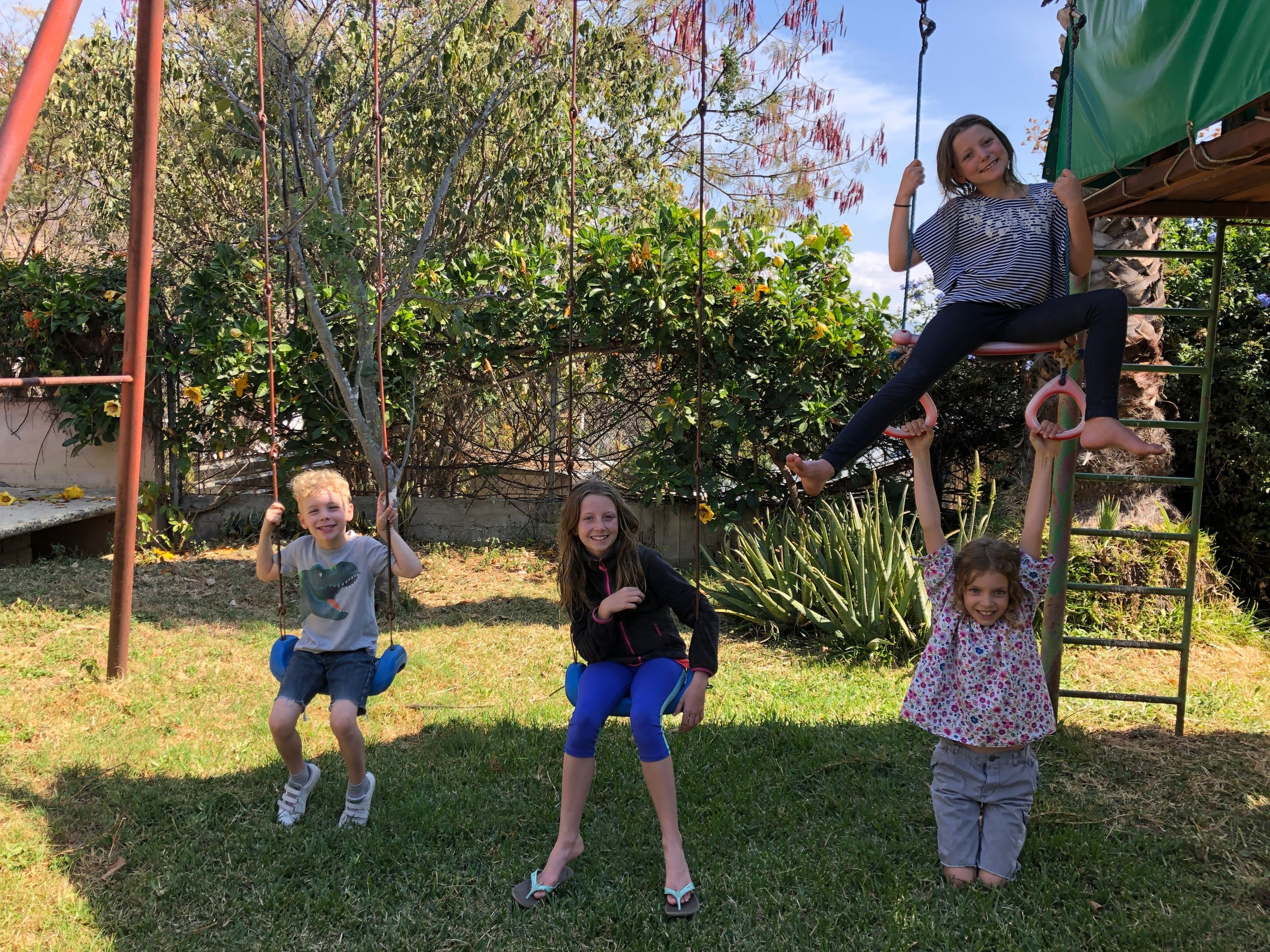 Louis, Ellie, Harlie and Isla on the play structure at our house in San Felipe del Agua