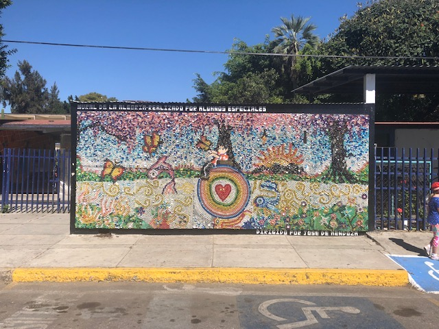 This mural is made up of bottle caps of varying colors!