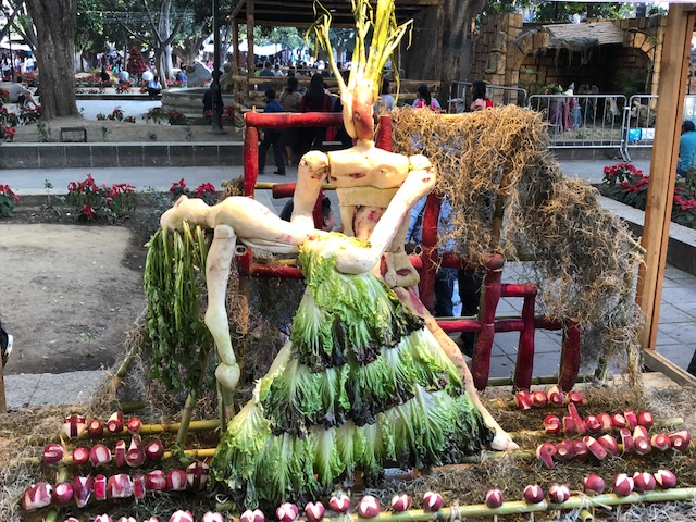 Art at the Radish Festival - the hair is cilantro, the skirt is made out of lettuce, the bodies are radishes