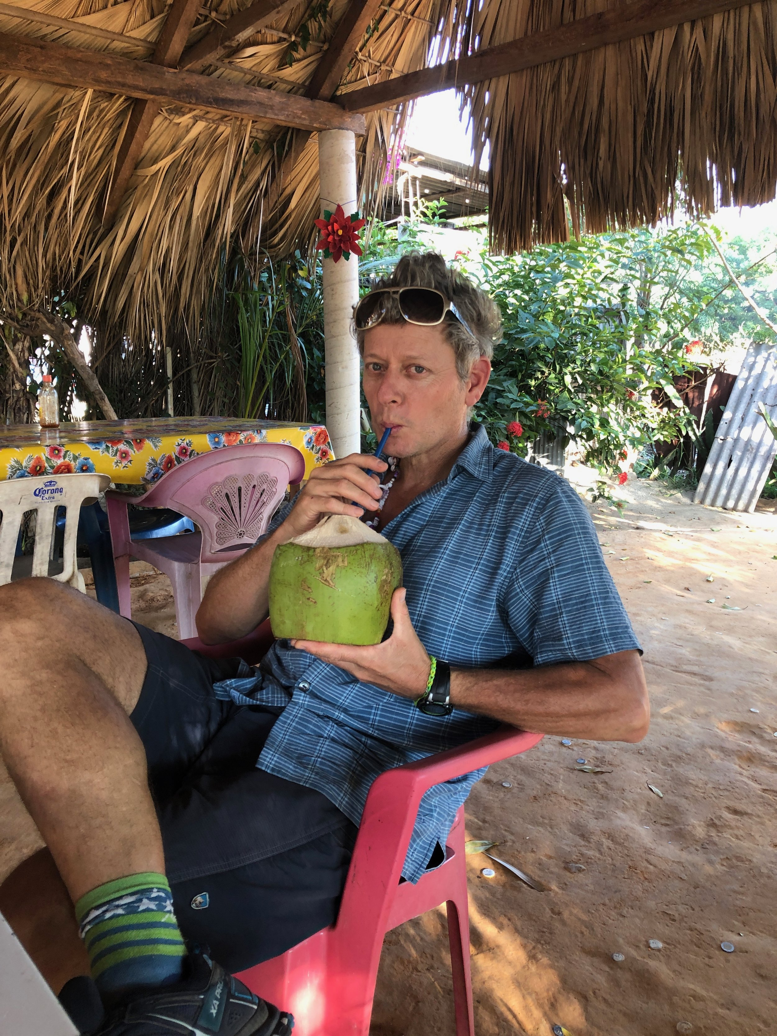 John sipping a coco frio (cold coconut water). We stopped to stretch our legs and get a refreshing drink once we hit the main highway. These cocos may have been the best of the whole trip!