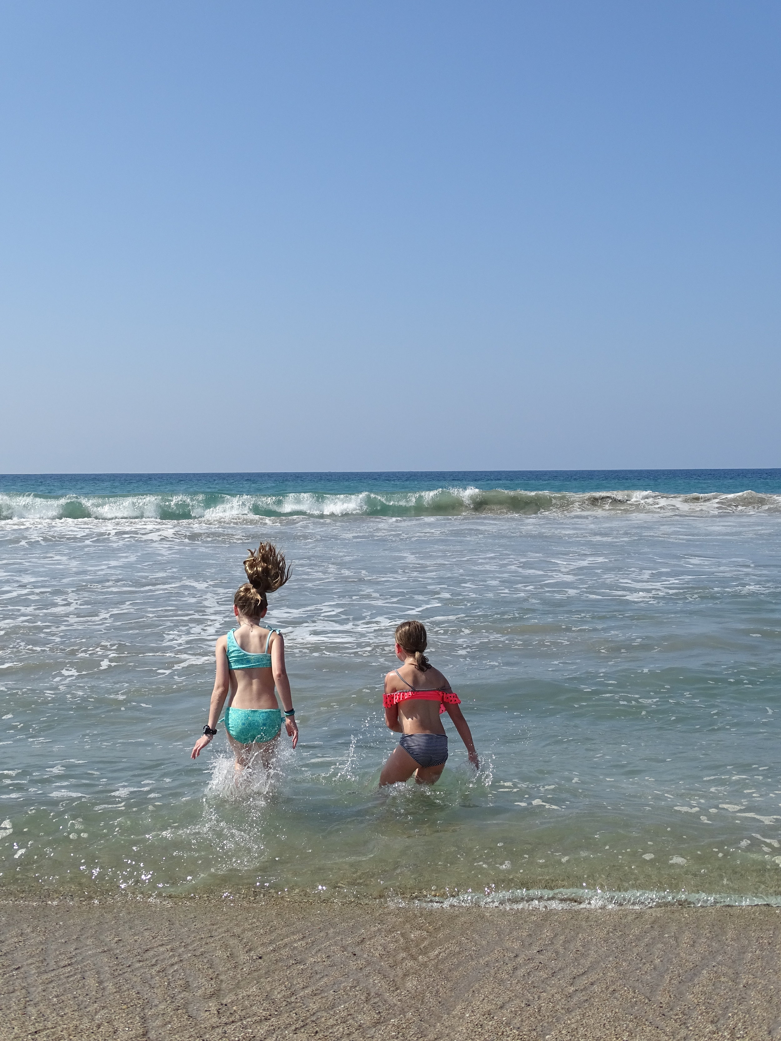 Ellie and Isla love to play in the waves and water