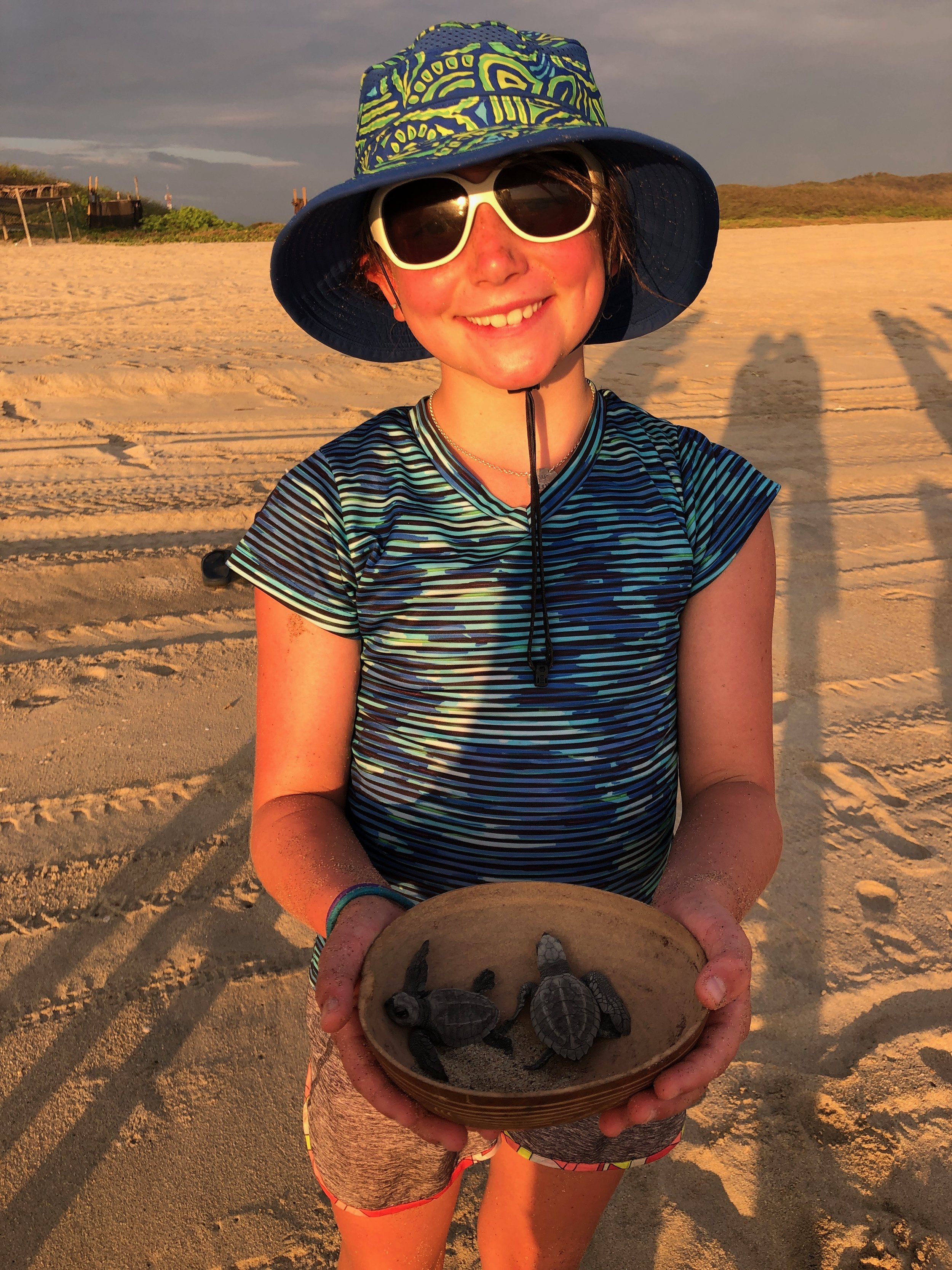 Isla with some turtles