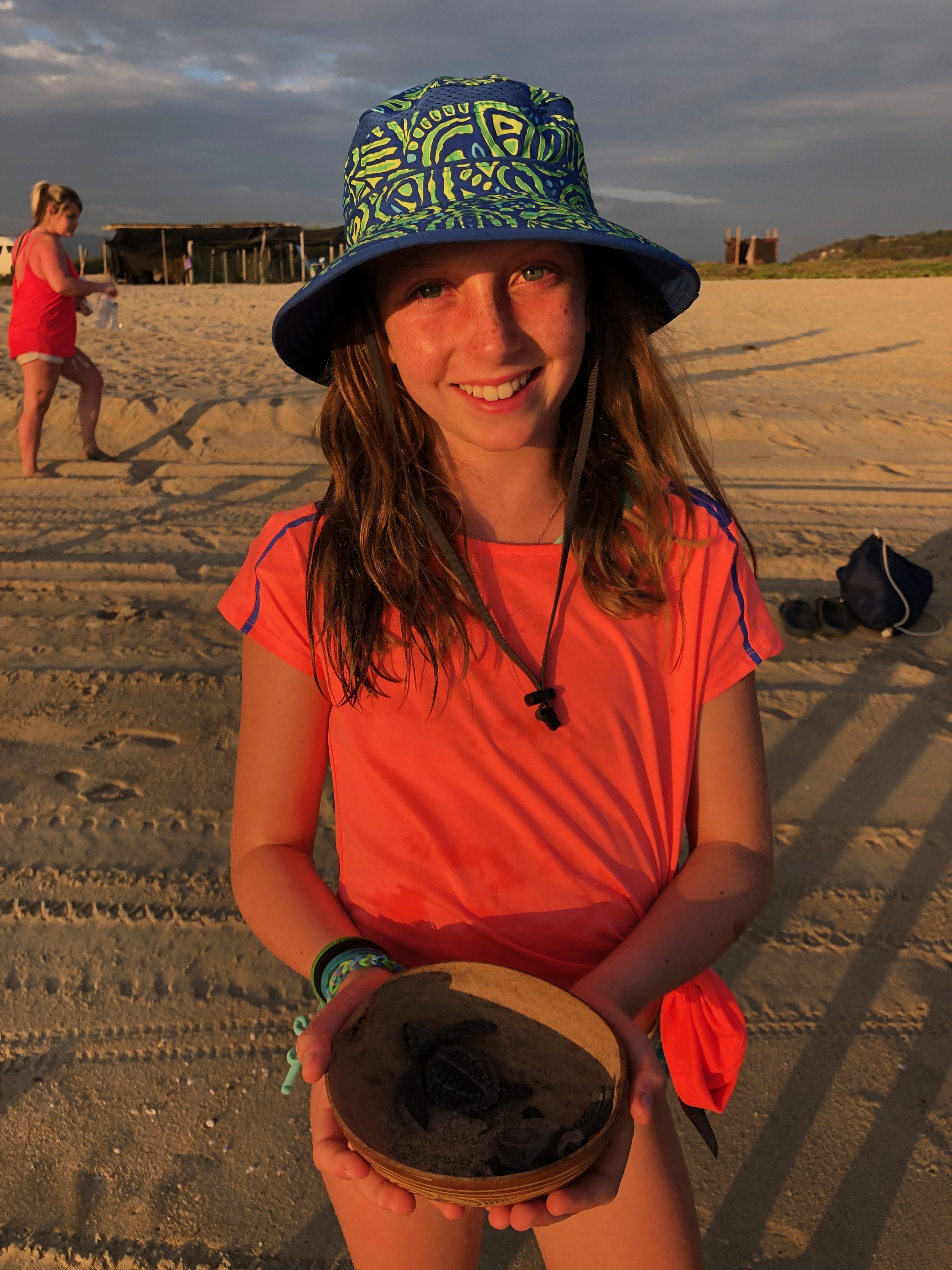 Ellie getting ready to release some turtles.
