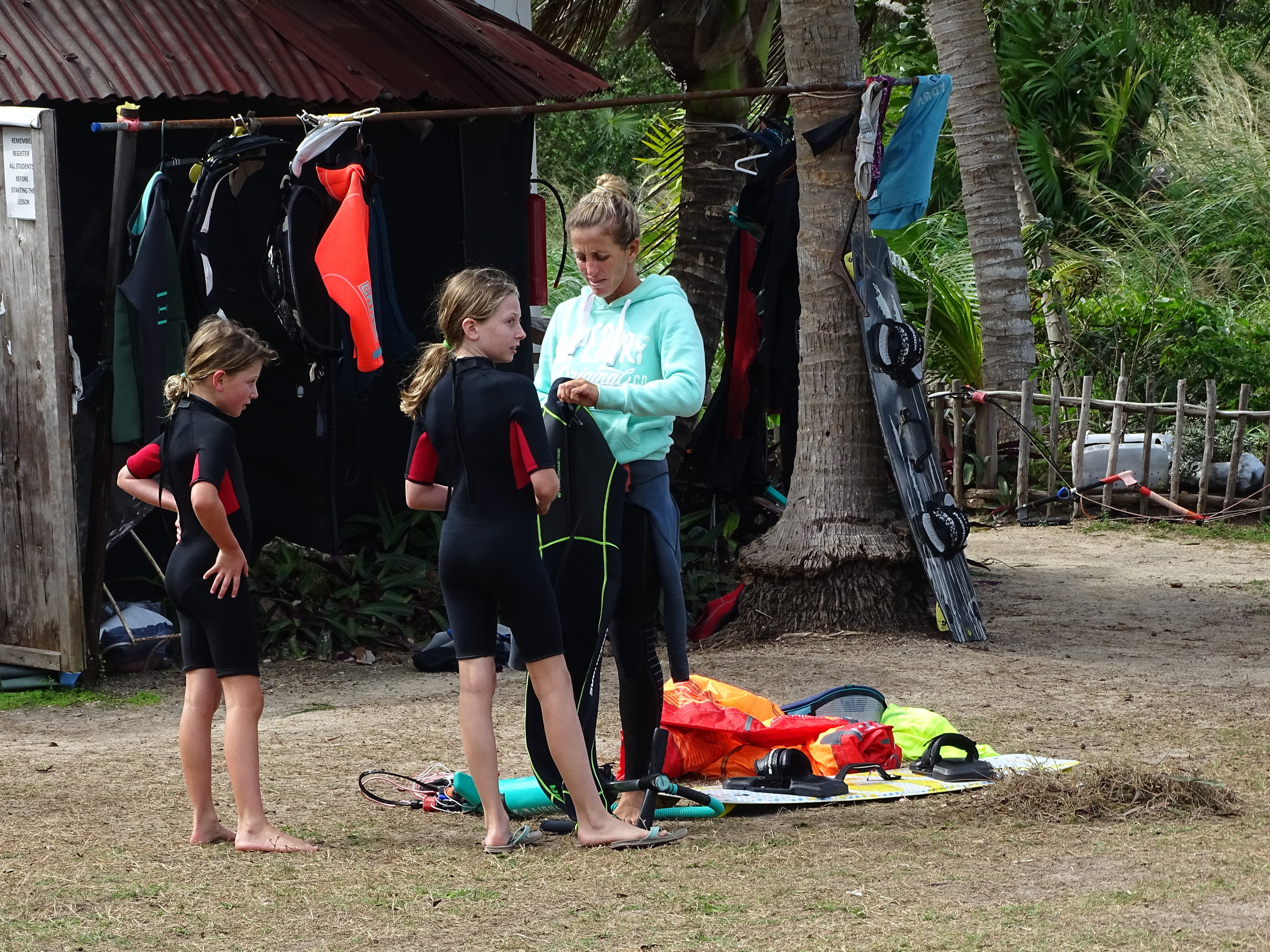 Getting their wetsuits on