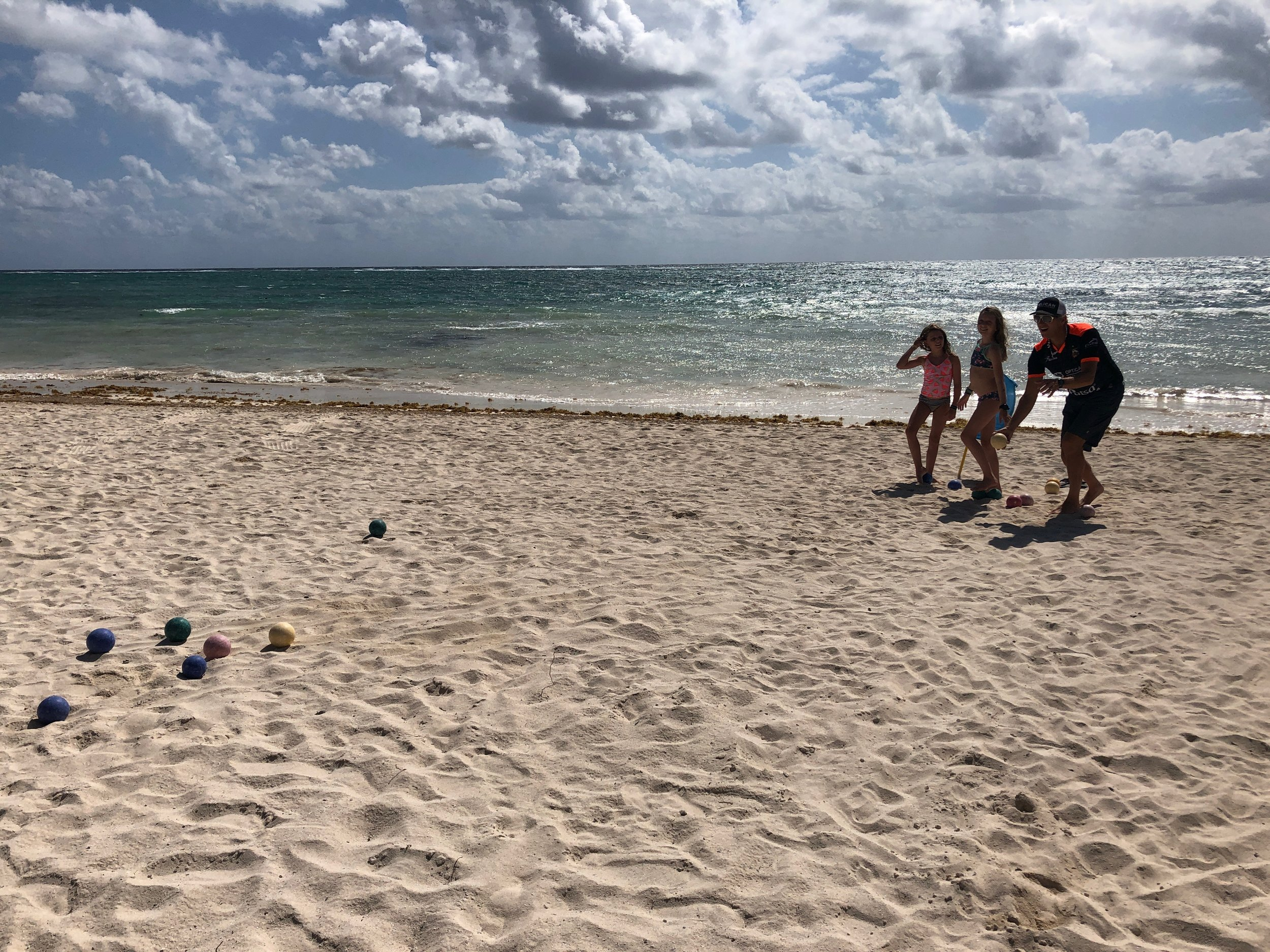 A family game of bocce on the beach