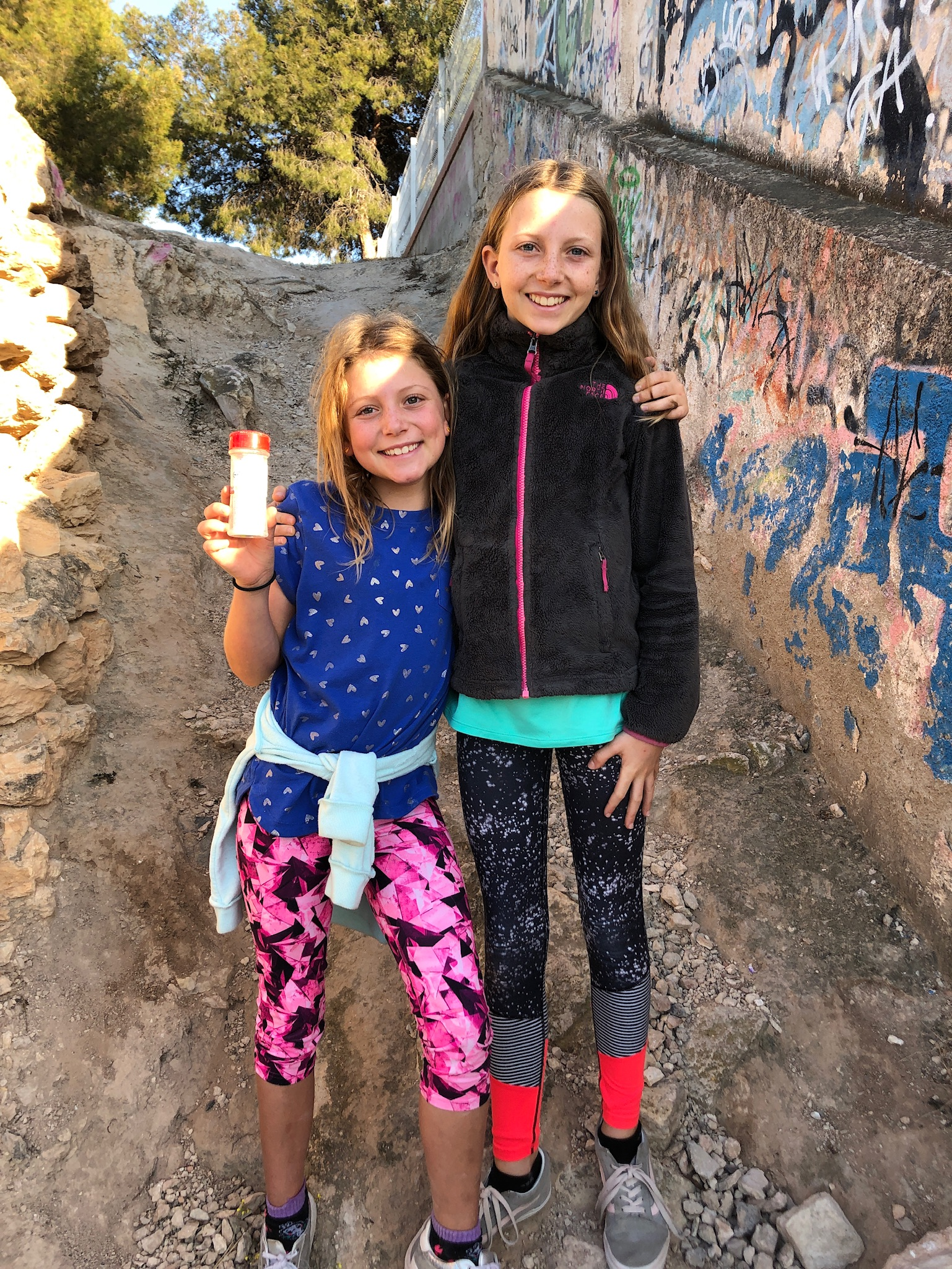 The girls with the first Geocache we found.
