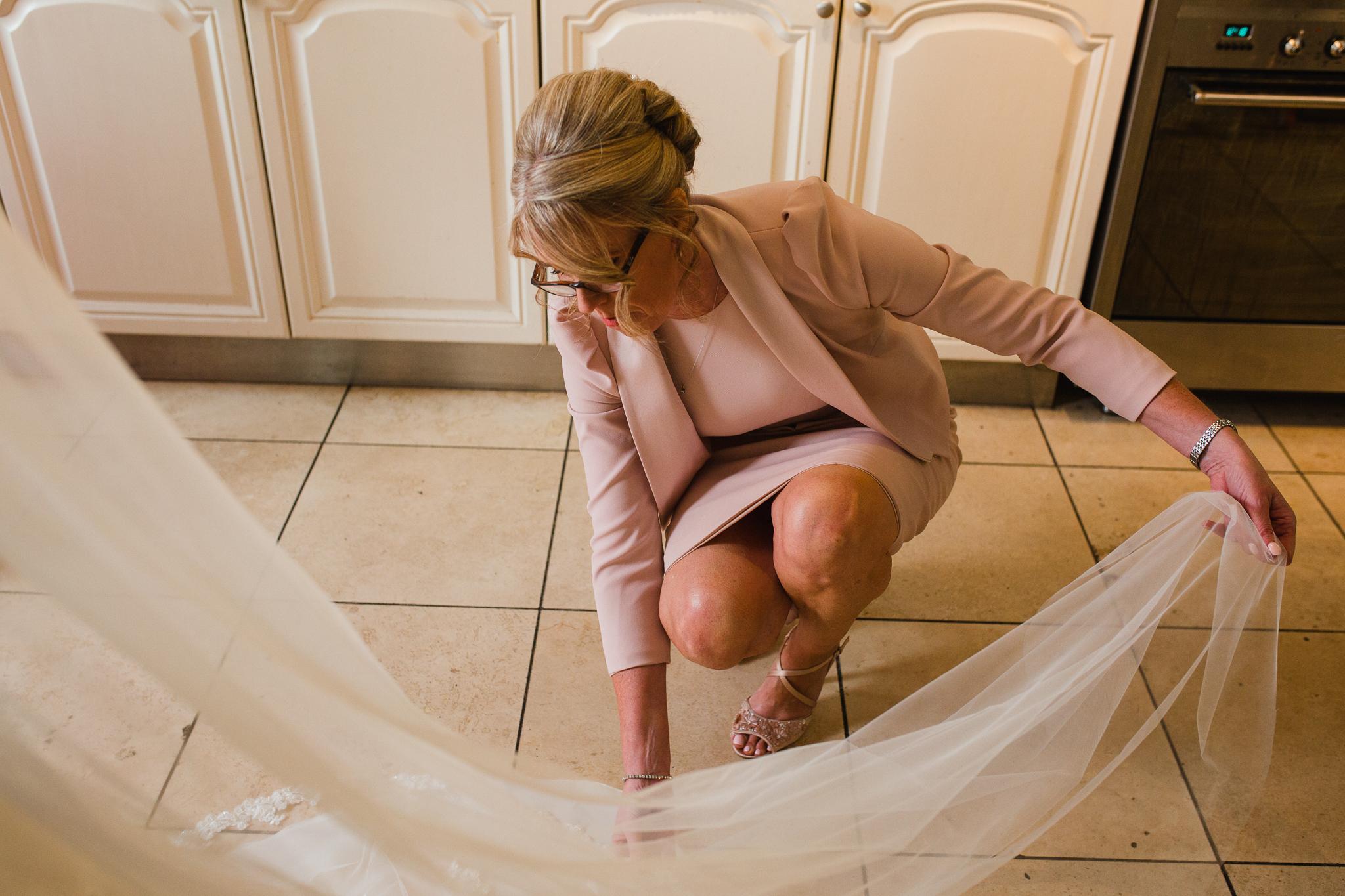 Jess and Ben - Liverpool wedding - mum arranging veil