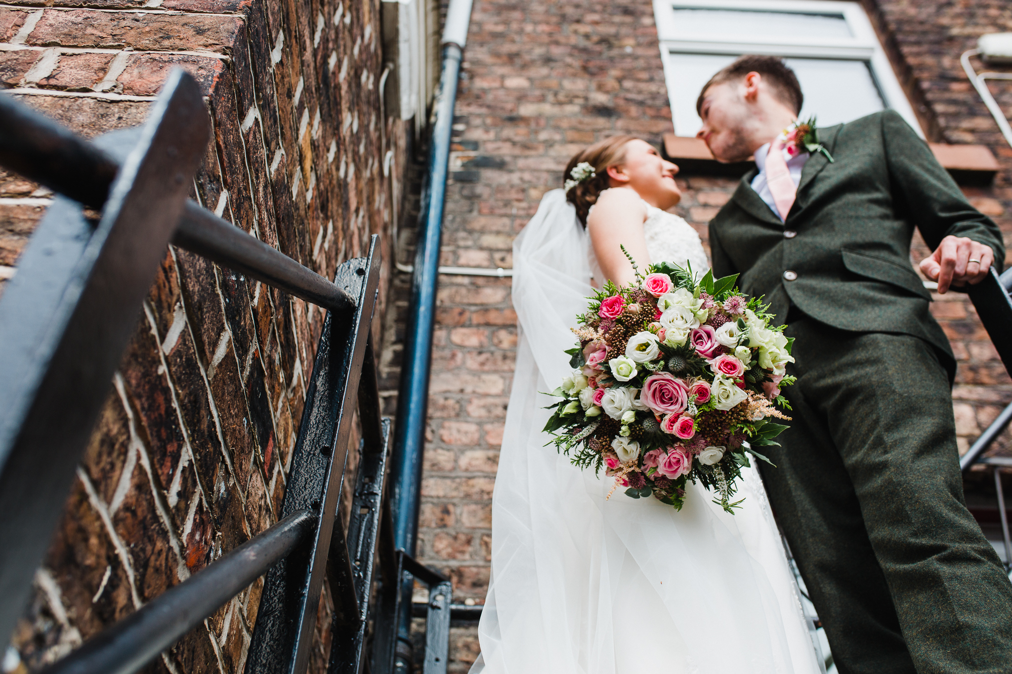 Jess and Ben - Liverpool wedding - bride and groom portrait on the steps