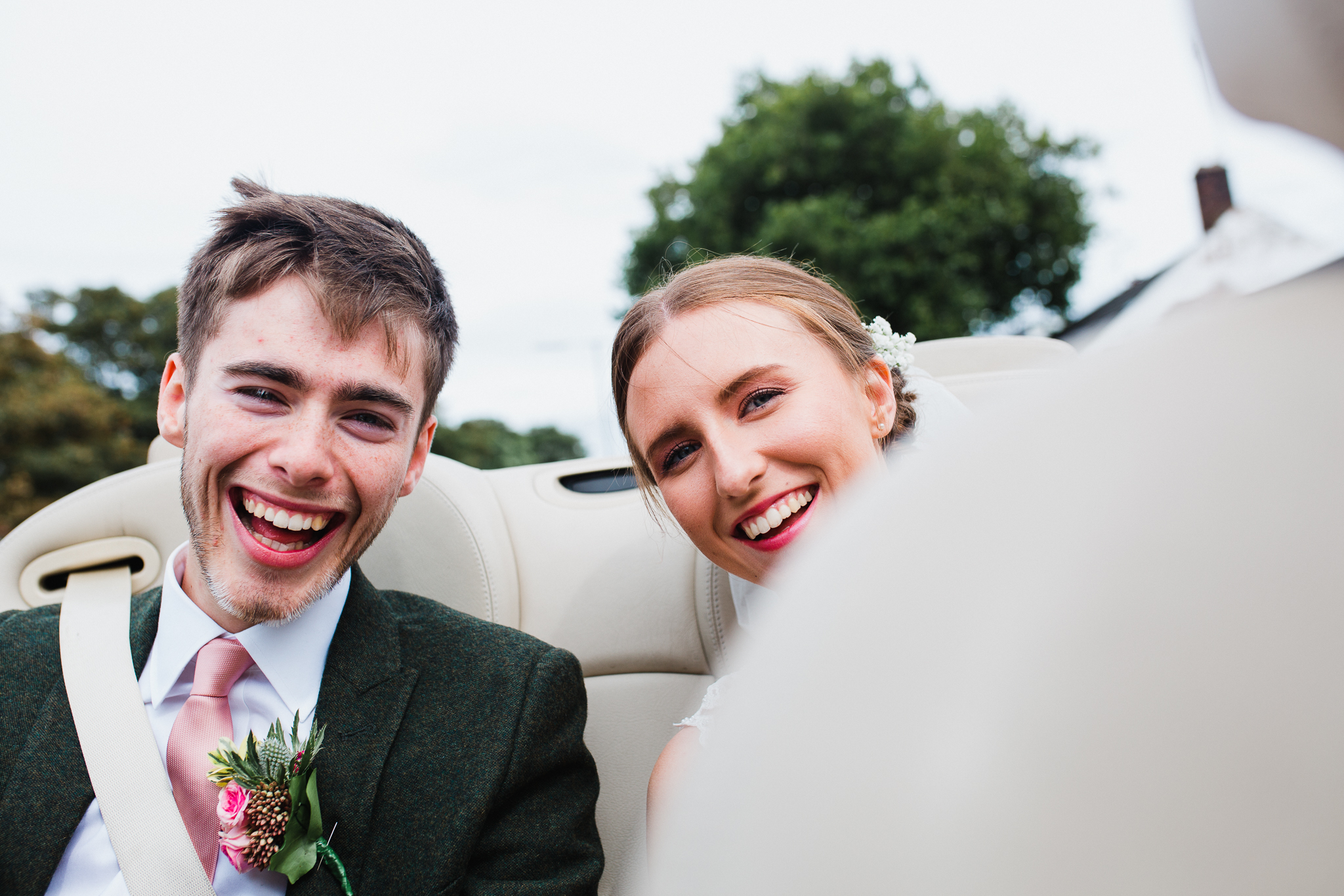 Jess and Ben - Liverpool wedding - bride and groom in the wedding car
