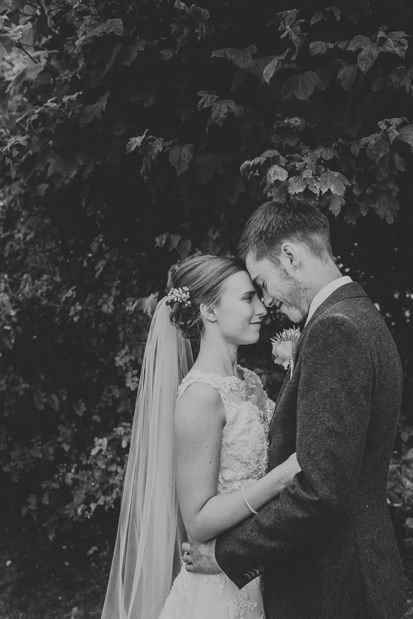 Jess and Ben - Liverpool wedding - black and white bride and groom embracing