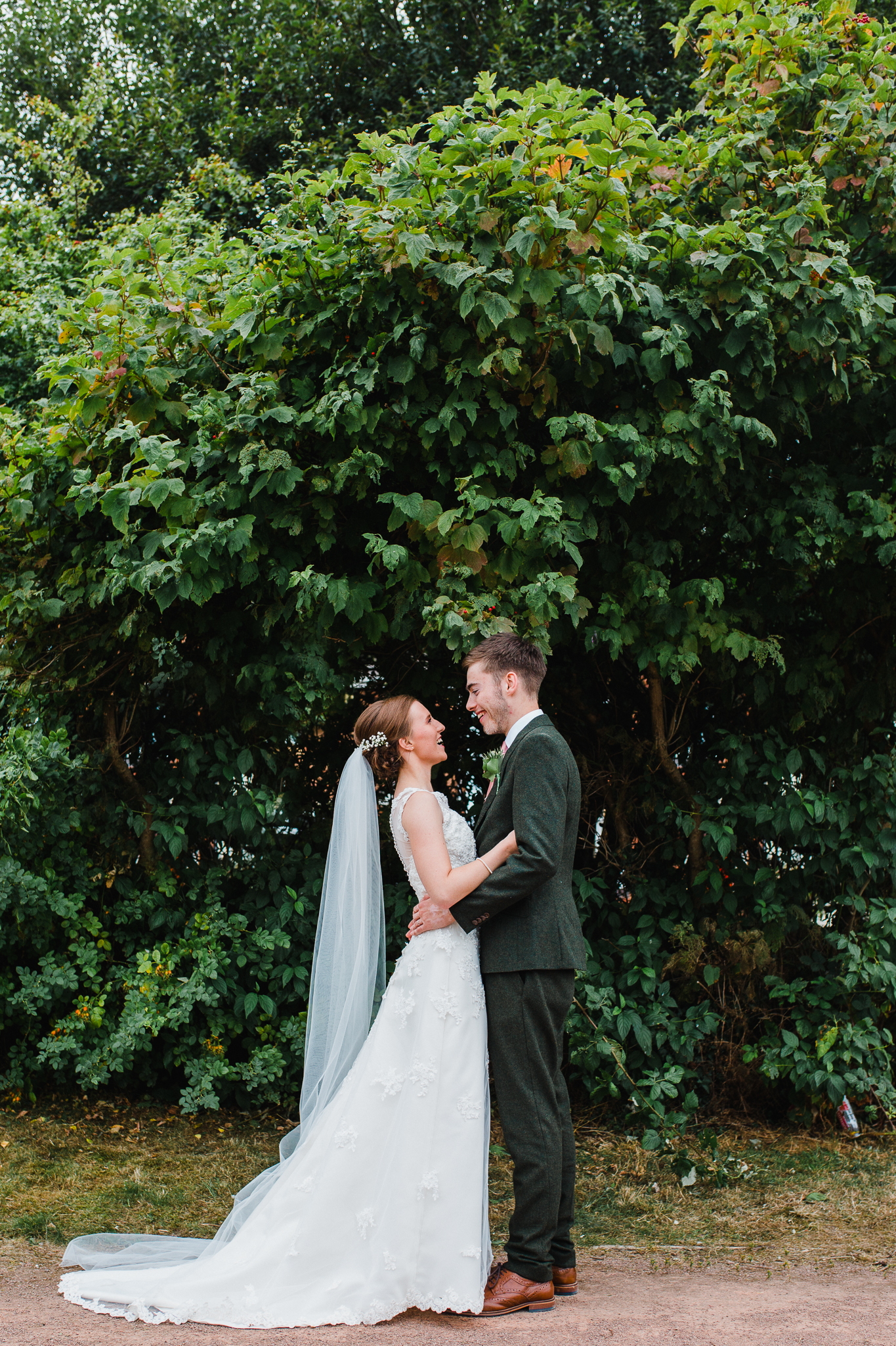 Jess and Ben - Liverpool wedding - bride and groom laughing