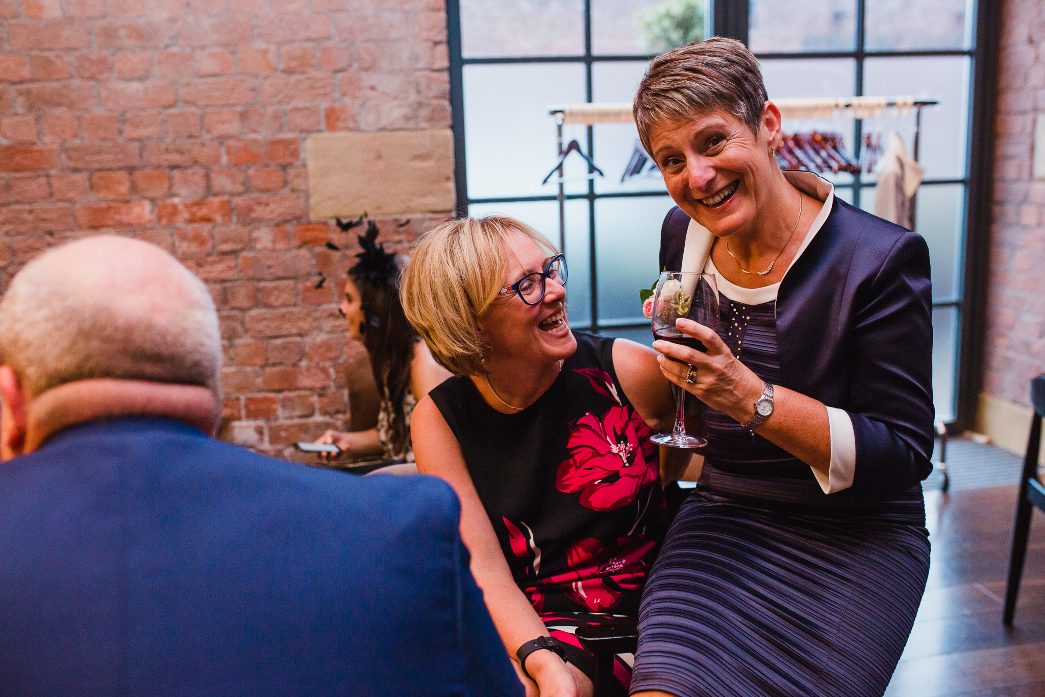 Jess and Ben - Liverpool wedding - guests laughing