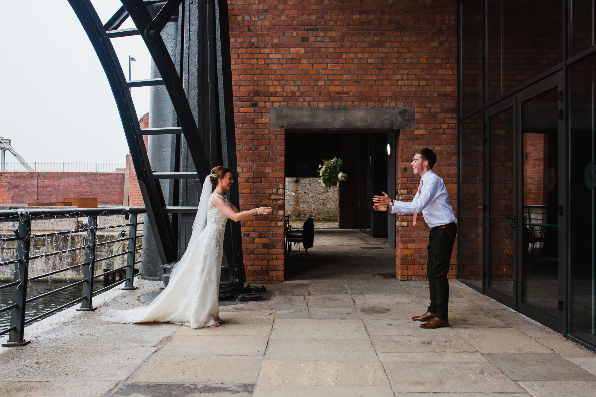 Jess and Ben - Liverpool wedding - bride and groom playing catch with the bouquet