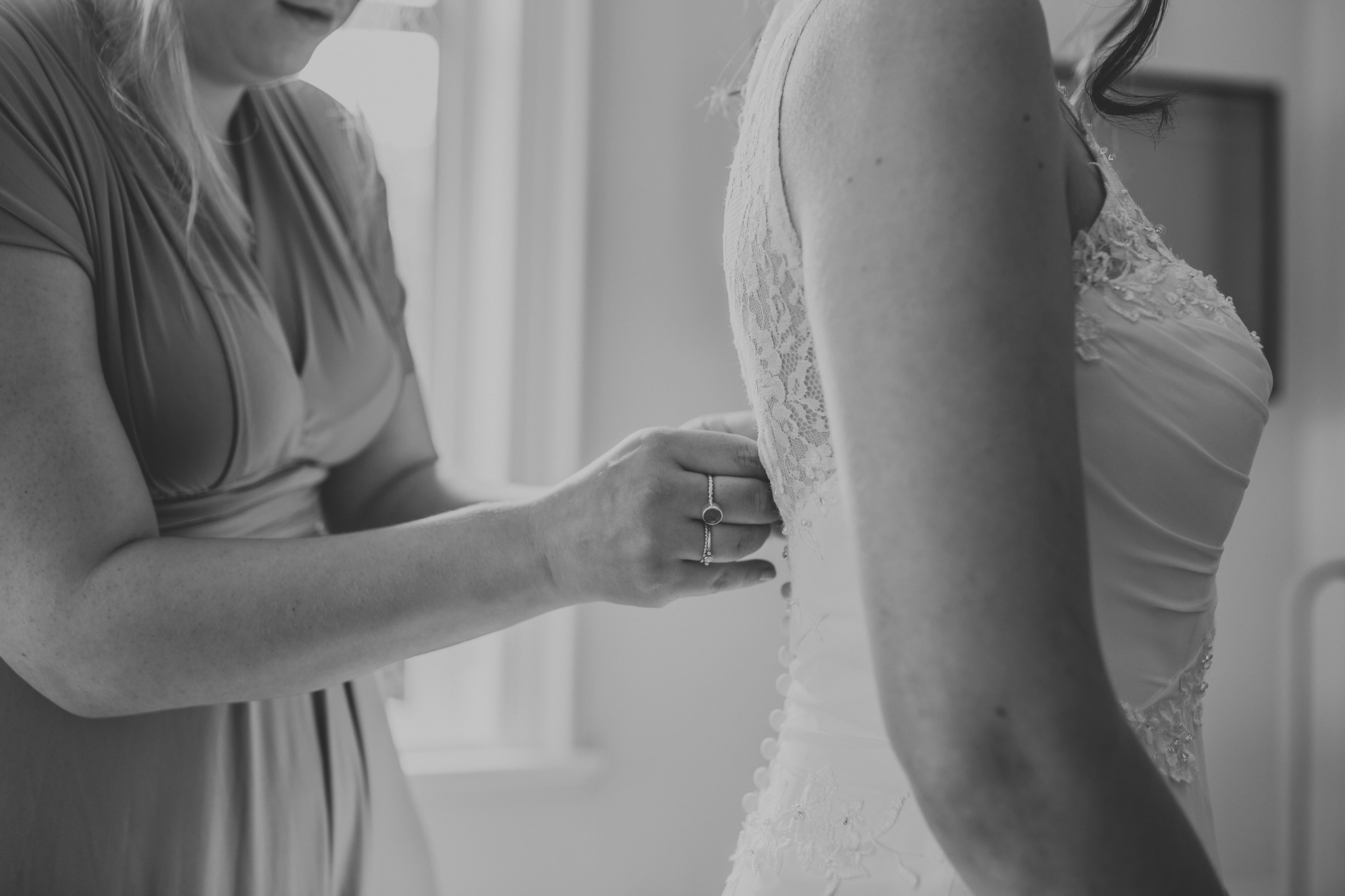 detail shot of buttoning wedding dress