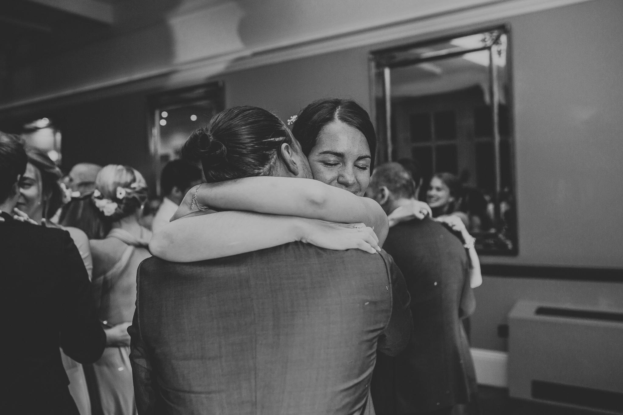 bride and groom hugging on the dance floor