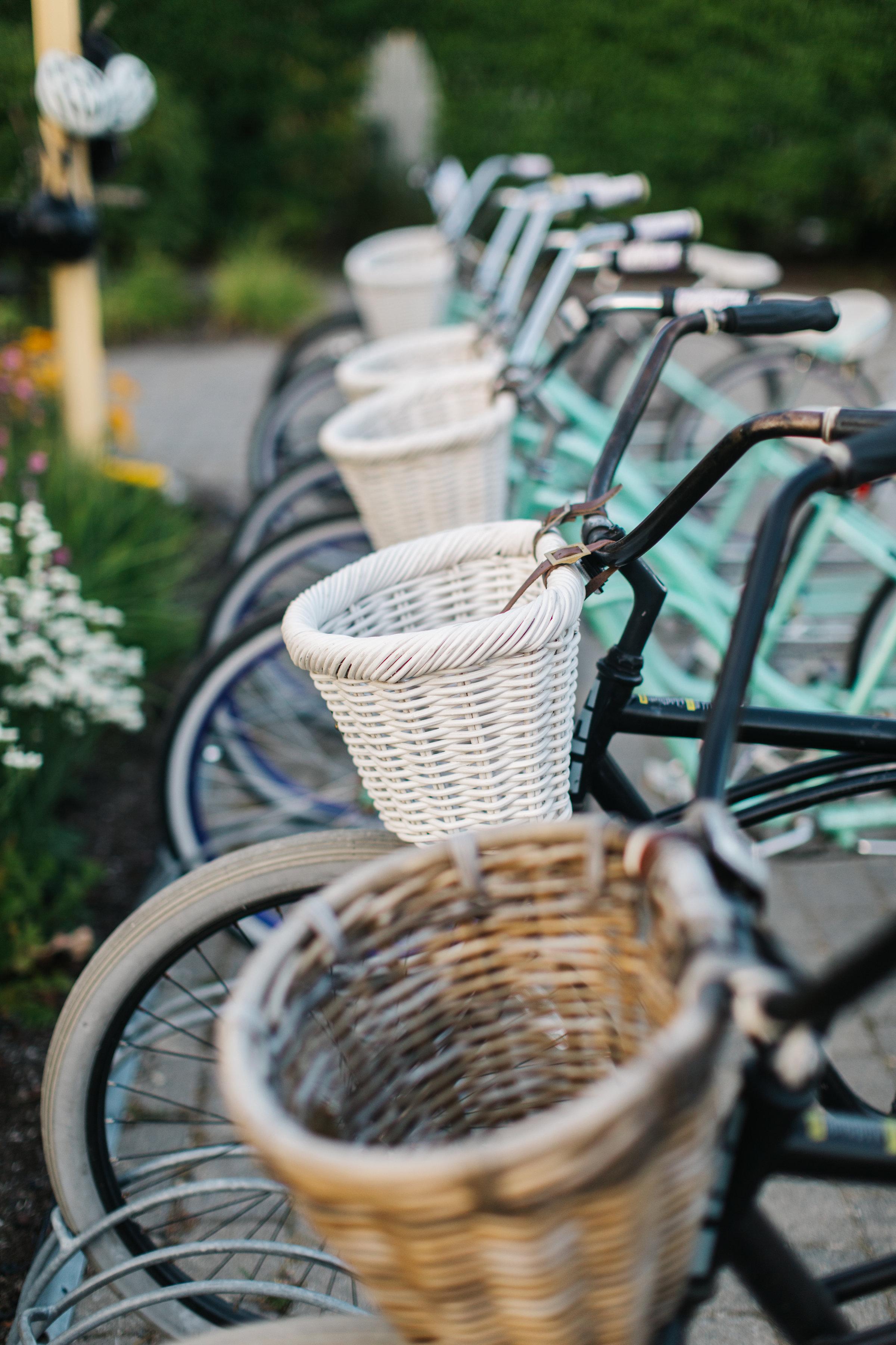 Bikes with woven bicycle baskets on handlebars