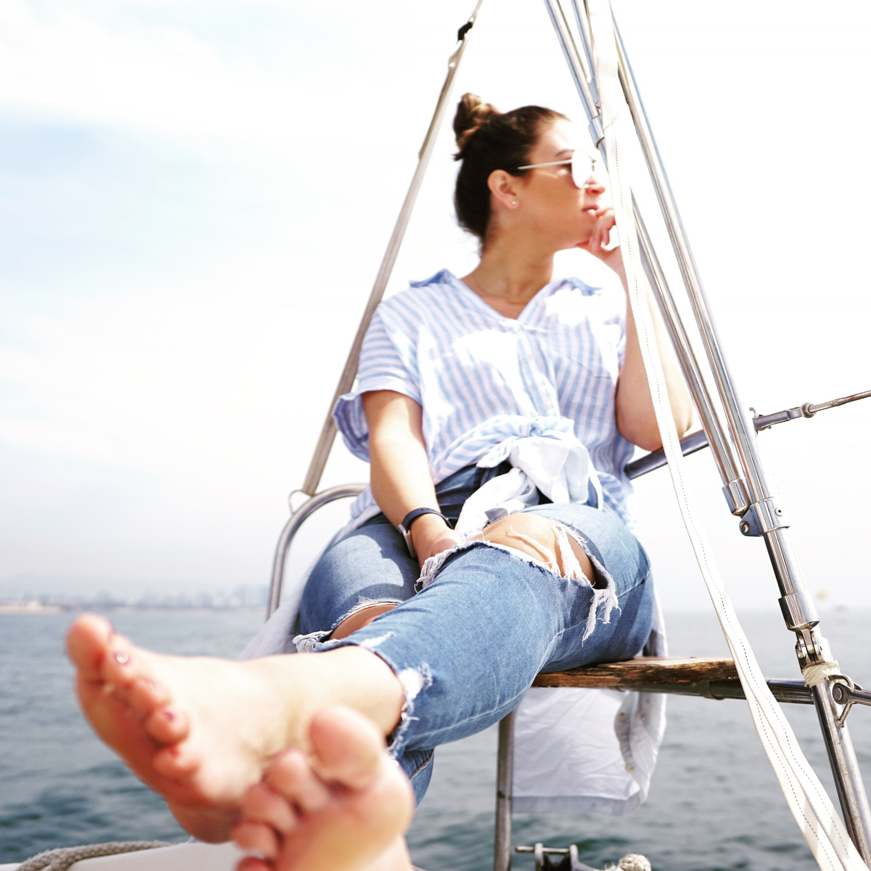 woman relaxing on yacht in marina