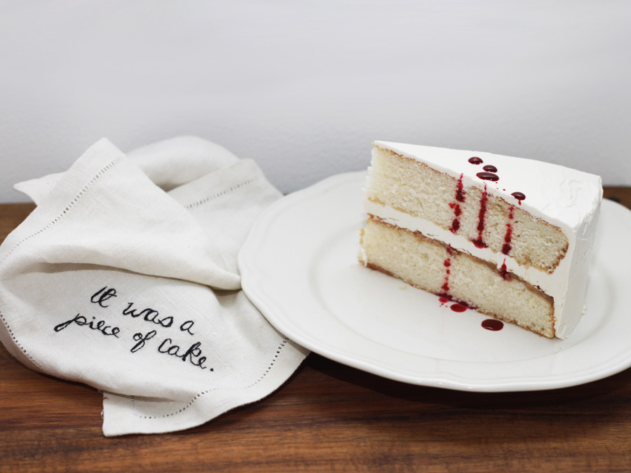 It Was a Piece of Cake - A mixed-media piece of hand-embroidery on a linen napkin and two layers of White Cake with White Swiss Meringue Buttercream. The rest is up to viewer interpretation.