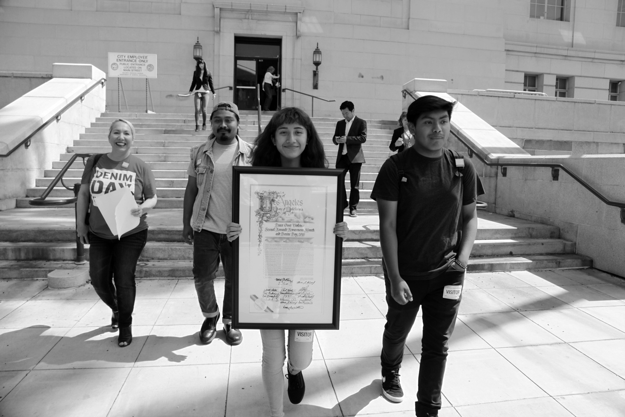 Youth Leaders and POV Staff exit LA City Hall and join the Denim Day Rally and Press Conference.
