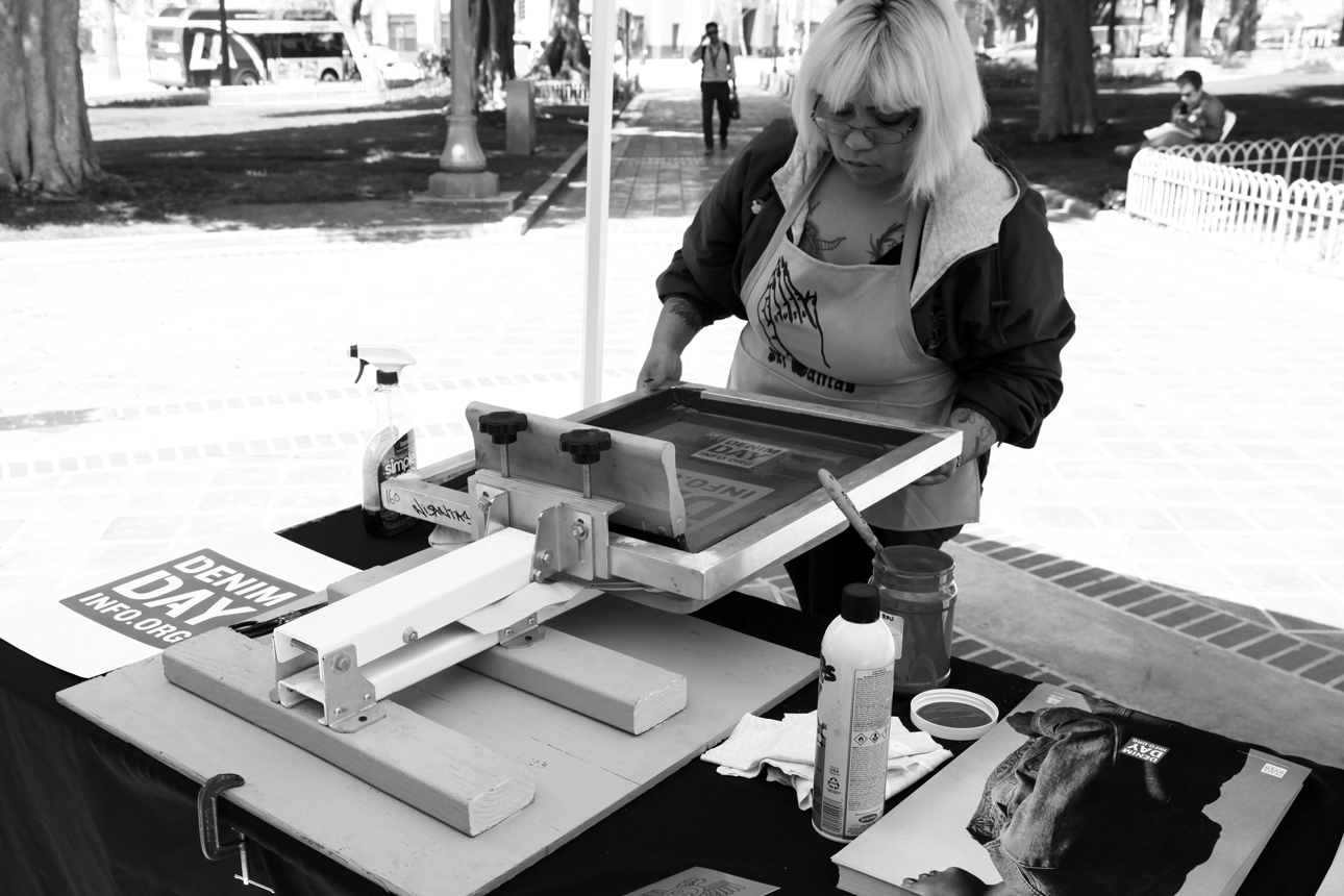 Ni Santas helped us spread the word about Denim Day by doing some live screen printing at our Rally.