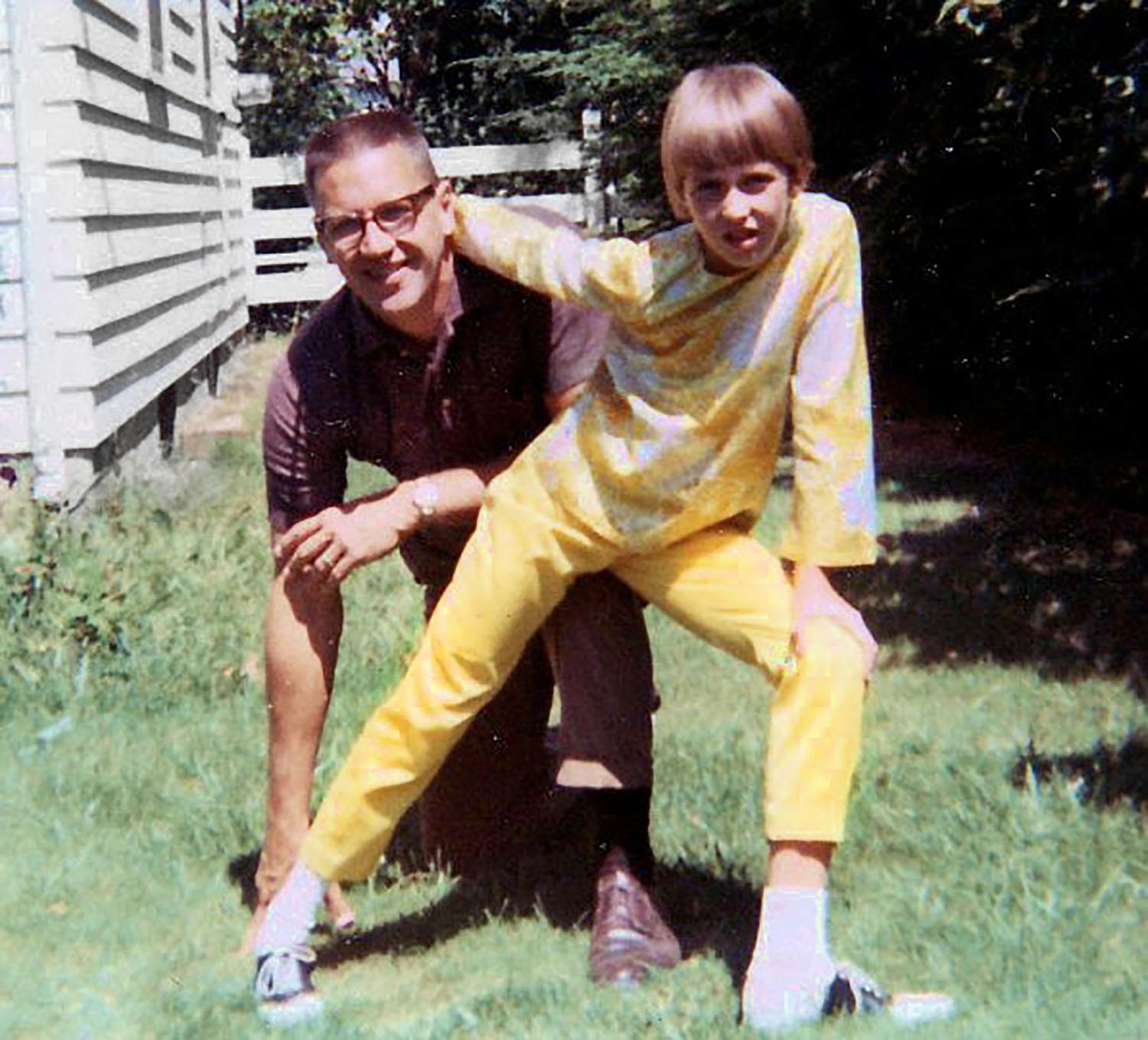 Me, age 8, posing here with Dad. Are we ready to play football?