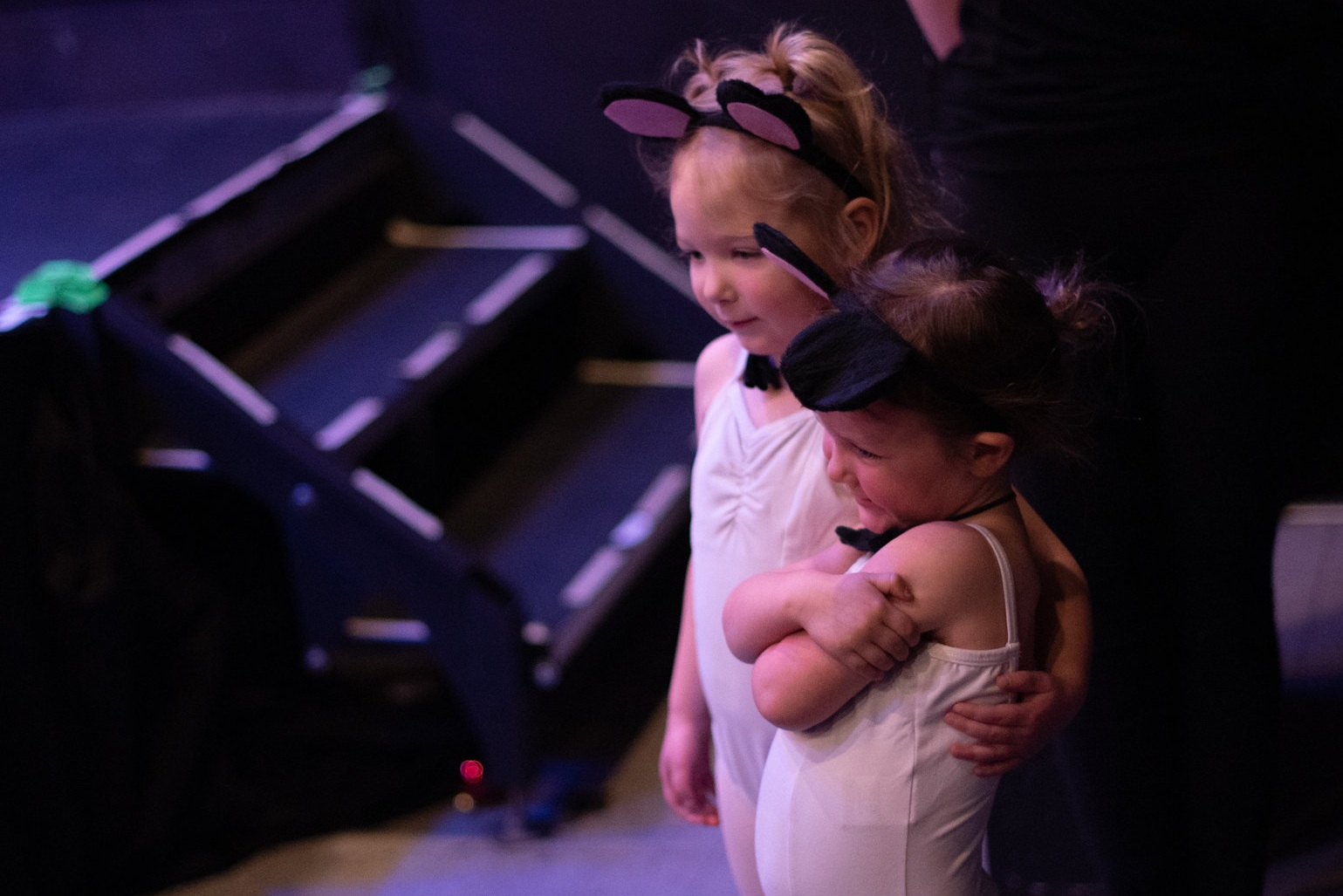 "pRE-PRIMARY dance - Pre-Primary student, Poe, gives her classmate Rukah an assuring hug prior to the start of ""A Winter's Tale"" student production.""Photo courtesy of Garner & Co."