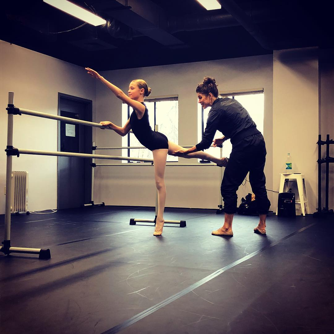 Intermediate YOUTH BALLET - Our Intermediate Ballet Classes build upon set Primary skills. We set attainable expectations for our students, allowing them to improve their skills in a timely manner.Our NYC Faculty member, Caitlin Abraham, works our student Madison on barre technique.
