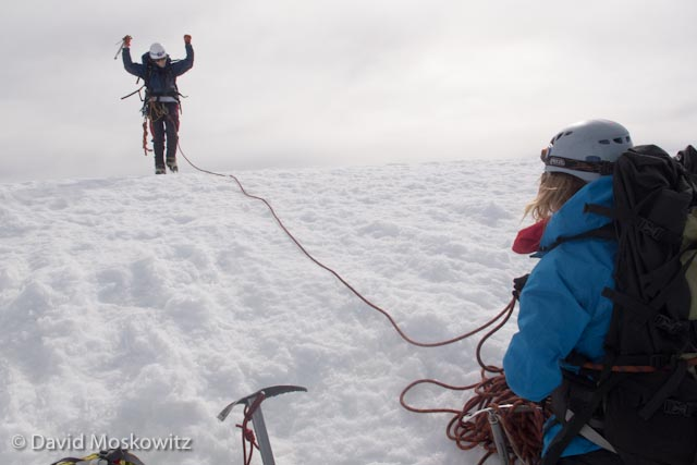 After leading the final pitch of the climb, Jess Stuecklen belays Laura Berglund as she crests the summit of Mount Hood, the tallest peak in the Oregon Cascades.