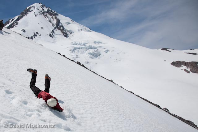 Outward Bound Instructor Sam Ecenia self arrests after a face first digger. Being able to stop yourself from sliding on steep snow is a fundamental alpine climbing skill.