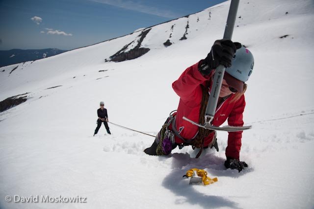 "Jess bounds in a snow anchor. Participants had 15 minutes to construct an anchor and transfer the ""fallen climber"" to it during this drill."