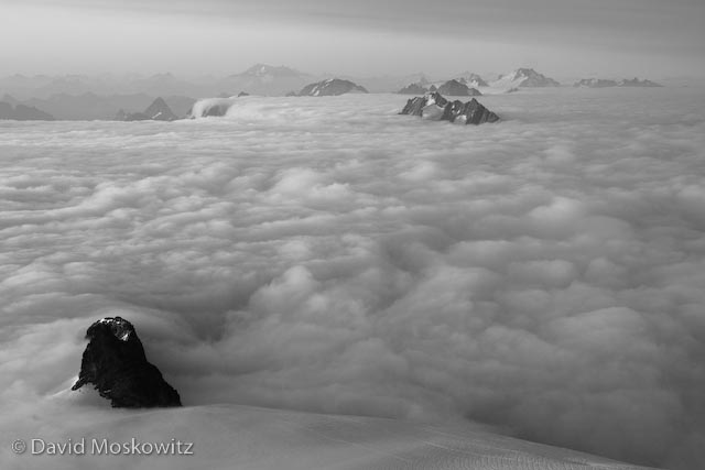 Looking south from the summit across a sea of clouds with only the highest peaks of the North Cascades jutting up like islands.