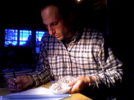 Drawing badger tracks from a plaster cast.Vashon Island, Washington.