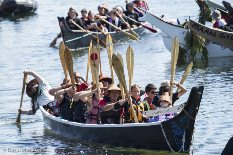 Skipper and canoe-builder Michael Evans presents Blue Heron Canoe of the Snohomish people, at the landing ceremony in Bella Bella.