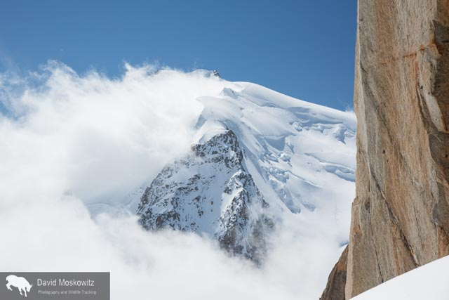 At 4810 meters (15,781 feet), Mount Blanc is the highest peak in the Alps. Clouds stream off of the lee side of the heavily glaciered peak.
