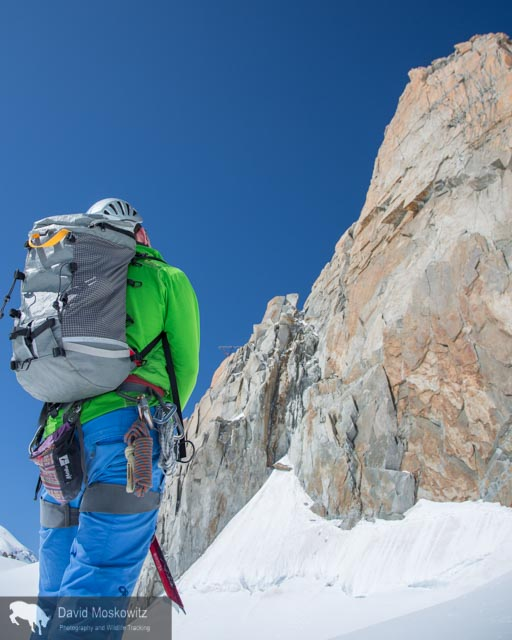 Forest McBrian examines the Eperon des Cosmiques route before our ascent.