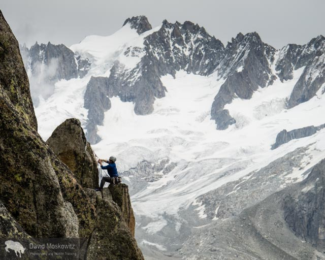 Mountain guide  Miles Smart at a belay on a route above the Envers hut.