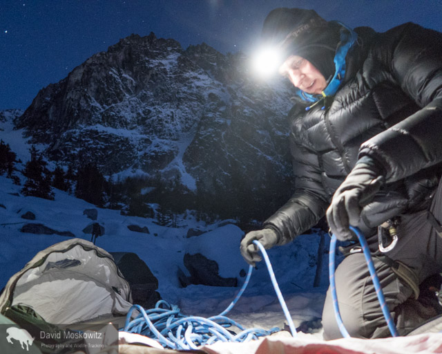 Cam Alford making his bed for our brief evening at Colchuck Lake, using our climbing rope as part of his mattress.