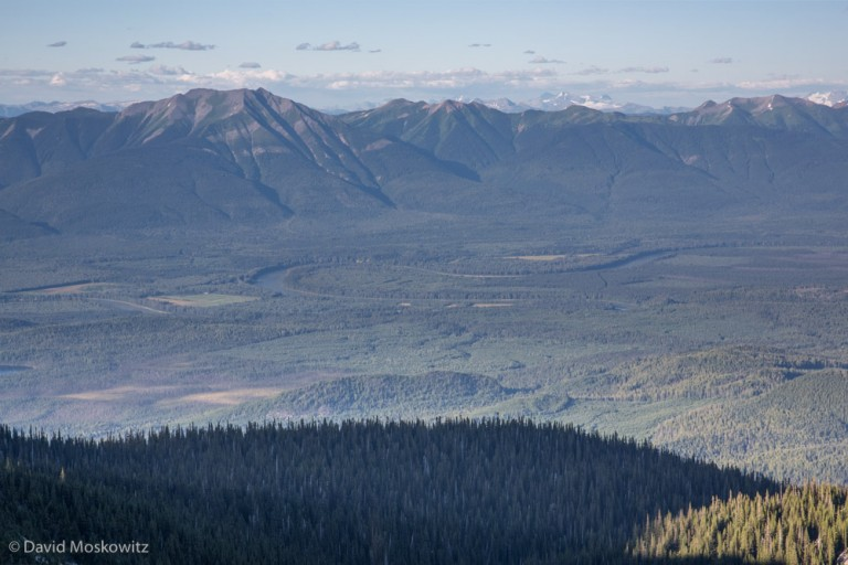 Looking across the Rocky Mountain Trench at the Hart Mountains from the Cariboo Mountains. The Fraser River oxbows through the trench which divides these two mountain ranges.