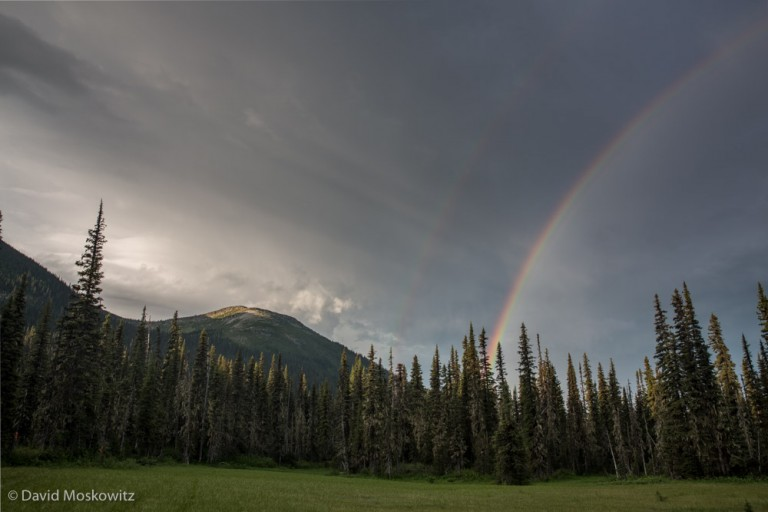 A double rainbow at sunrise precedes a violent thunderstorm that rolled across the landscape shortly afterwards.