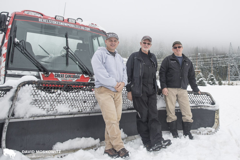 Daniel Kellie (left), owner of  Great Canadian Snowmobile Tours and president of the  Revelstoke Snowmobile Club , and club members Ron LaRoy (center), and Brad McStay lean on the front of one of the clubs groomers used to maintain the network of snowmobile trails the club manages all winter. Daniel noted that interest in snowmobiling in the Revelstoke area is growing, adding pressure to the areas currently easily accessible and legally open to to snowmobiling, a number of which have known mountain caribou populations.