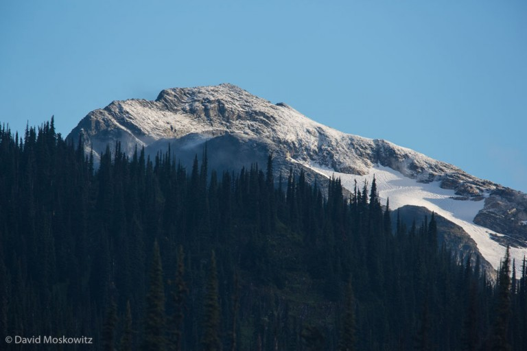 Fresh snow on the summit of a peak in the Columbia mountains after a summer storm.