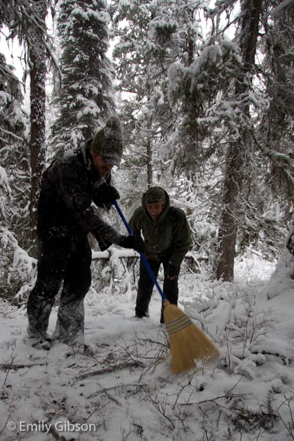 Heavy snow Saturday night and Sunday morning called for desperate measures. Here Adam Lieberg, Conservation Program Coordinator for Northwest Connections, uses a broom to brush snow off of sign we had found during our scouting for the evaluation.