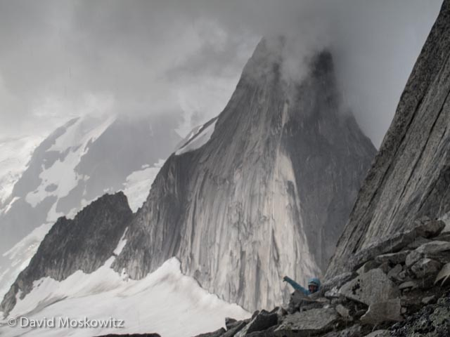 Just as we arrived to the base of the steepest section of Bugaboo Spire's northeast ridge an electrical storm rolled in. Erin shares her thoughts about the situation from where she hunkered down in the talus. Snowpatch Spire beyond disappears into the clouds.