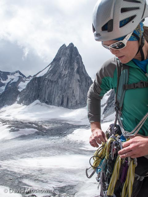 Erin racks up to lead out on MacTech Direct on Crescent Spire. Snowpatch Spire and the Crescent Glacier beyond.