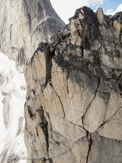 Jason Cramm on Paddle Flake Direct with the northeast ridge of Bugaboo Spire beyond.