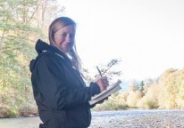 Naturalist Nicole Larson records her answers to track and sign questions along the Dosewallips River. Olympic Peninsula, Washington. Nicole earned a Level 2 Track and Sign Certificate.
