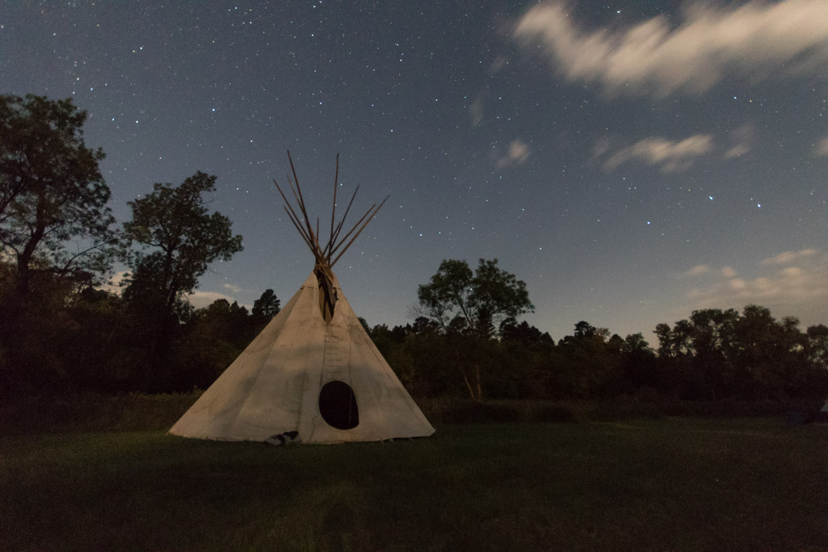 Moonlight on a teepee at All Nations.