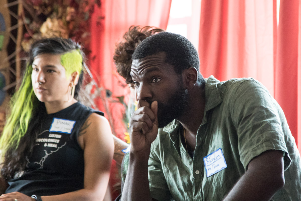 Ramon Parish, one of the facilitators for the gathering and a member of the Leadership Circle for Youth Passageways, listen intently during a talking circle..