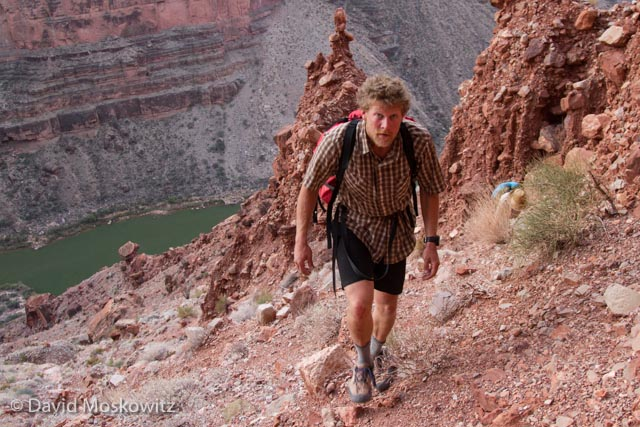 Ryan Audett trekking upslope from the Colorado River towards the canyon rim early in the morning.