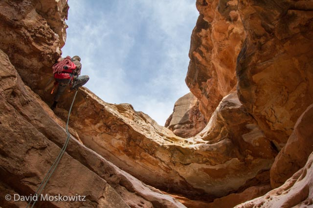 A tricky rappell for canyoneer Ryan Audett in Cove Canyon, which feeds into the Colorado River in the Grand Canyon, Arizona.